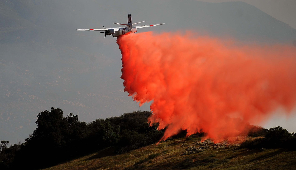 . An air tanker drops fire retardant on a 1,500 acre brush fire Wednesday May 1, 2013 in Banning. LaFonzo Carter/Staff Photographer