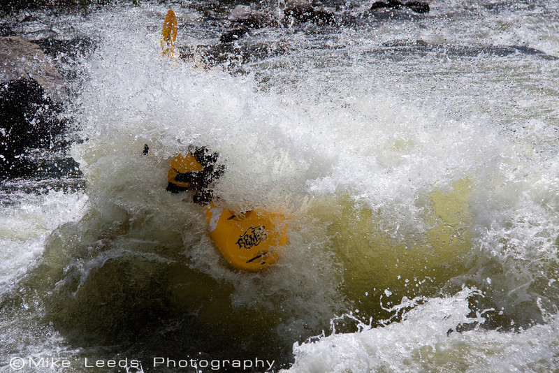 Brian Ward hitting the huge tombstone rock boof, Jaws 2 on the North Fork Payette River, Idaho.