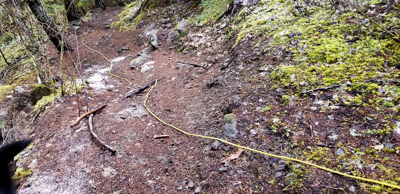 Someone has put a rope on one of the very steep sections of tread near the start.  One of the sections that did not get stairs installed