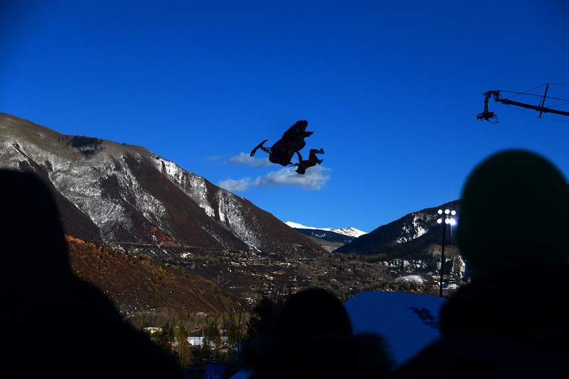 . A competitor catches big air at the snowmobile freestyle practice in Aspen at Winter X Games in Aspen, January 22, 2014. The snowmobile freestyle final will be held Thursday night on Buttermilk Mountain. (Photo By Mahala Gaylord/The Denver Post)