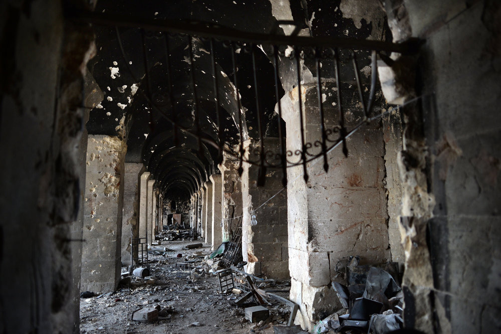 . A picture taken on April 16, 2013 shows the damaged arcades of Aleppo\'s iconic Umayyad Mosque complex which had served as a key battleground since last July, with rebels seeking the ouster of Bashar al-Assad\'s regime laying siege twice but each time only managing to retain control for less than 48 hours. Aleppo\'s ancient Umayyad mosque, which slid back into rebel control for a third time after prolonged clashes, offers a chilling window into the intractability of the Syrian civil war, now in its third year.   DIMITAR DILKOFF/AFP/Getty Images