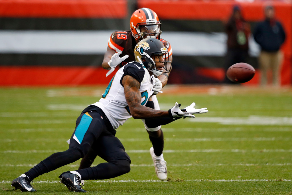 . Jacksonville Jaguars cornerback A.J. Bouye (21) intercepts the ball intended for Cleveland Browns wide receiver Corey Coleman (19) in the second half of an NFL football game, Sunday, Nov. 19, 2017, in Cleveland. (AP Photo/Ron Schwane)