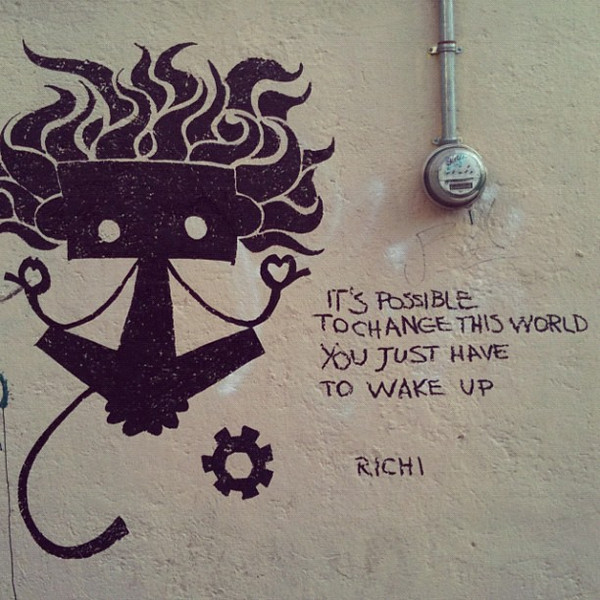 """It's possible to change this world. You just have to wake up."" Motivational graffiti in #oaxaca #mexico"