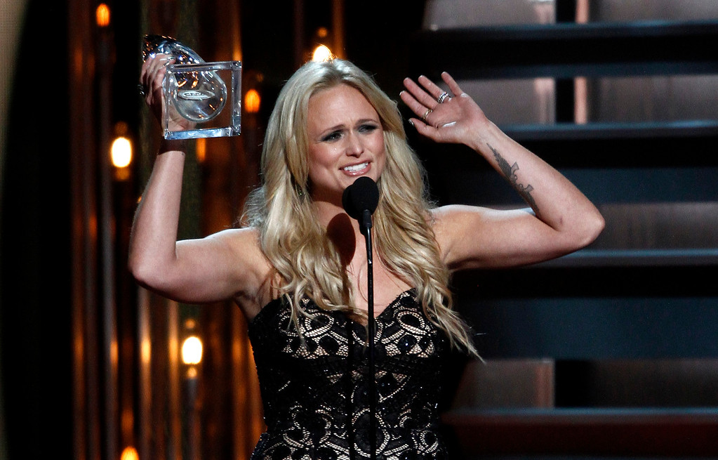 . Miranda Lambert accepts the award for female vocalist of the year at the 47th annual CMA Awards at Bridgestone Arena on Wednesday, Nov. 6, 2013, in Nashville, Tenn. (Photo by Wade Payne/Invision/AP)