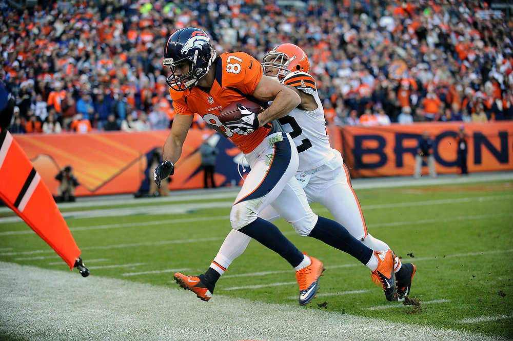 . Denver Broncos wide receiver Eric Decker is forced out of bounds by Cleveland Browns defensive back Buster Skrine in the second quarter Sunday at Sports Authority Field. Steve Nehf, The Denver Post