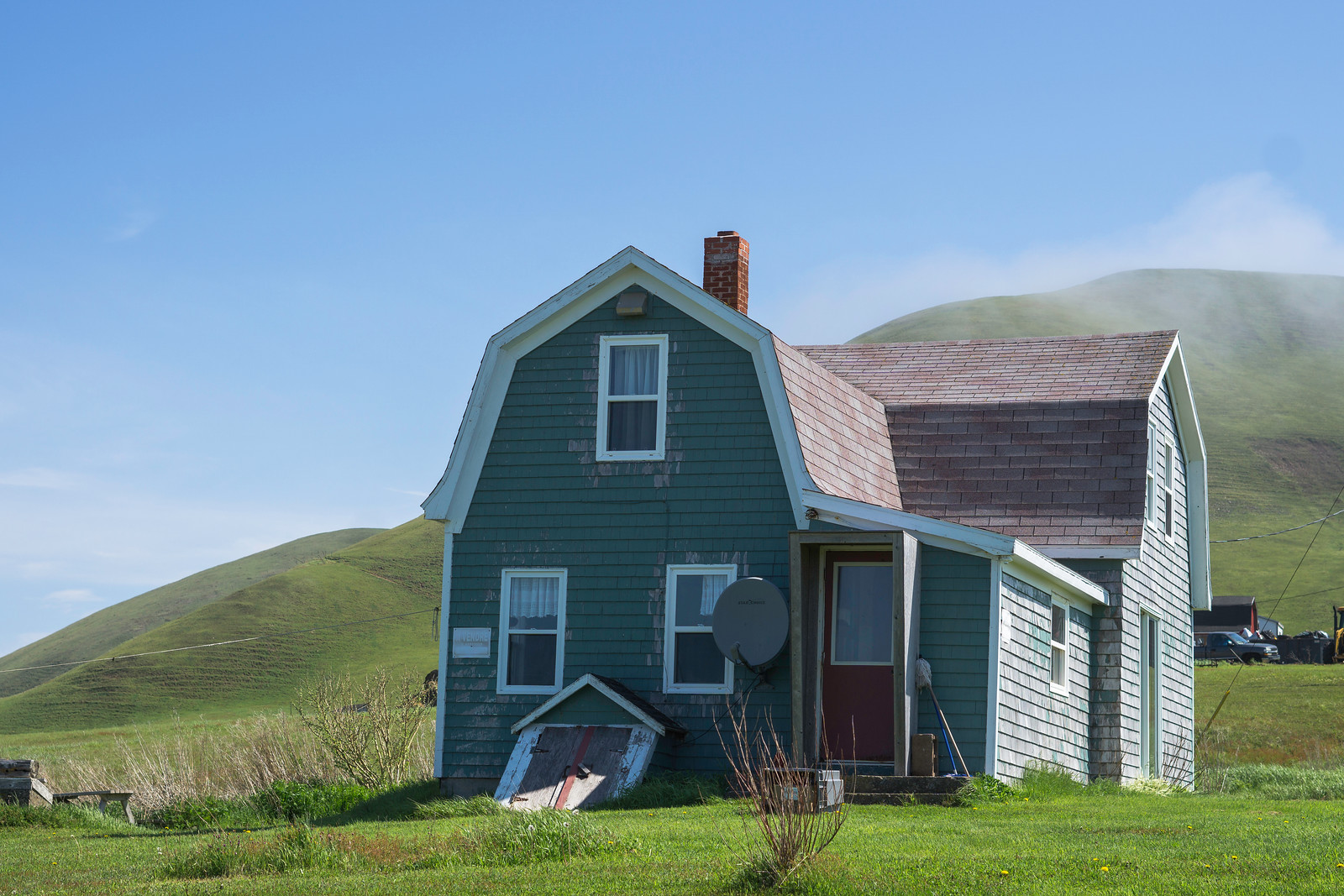 A traditional house nestled into the base of Big Hill on Île Entrée.