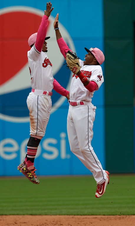 . Cleveland Indians\' Francisco Lindor, left, and Greg Allen celebrate after they defeated the Kansas City Royals in a baseball game, Sunday, May 13, 2018, in Cleveland. (AP Photo/Tony Dejak)