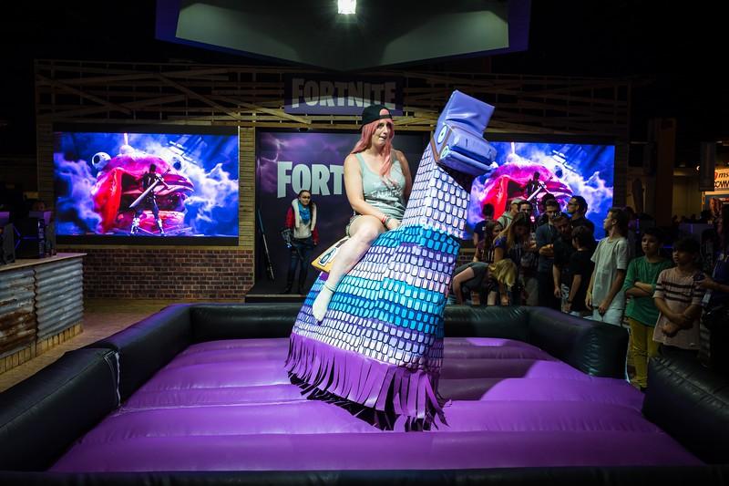 Riding the llama at Fortnite booth
