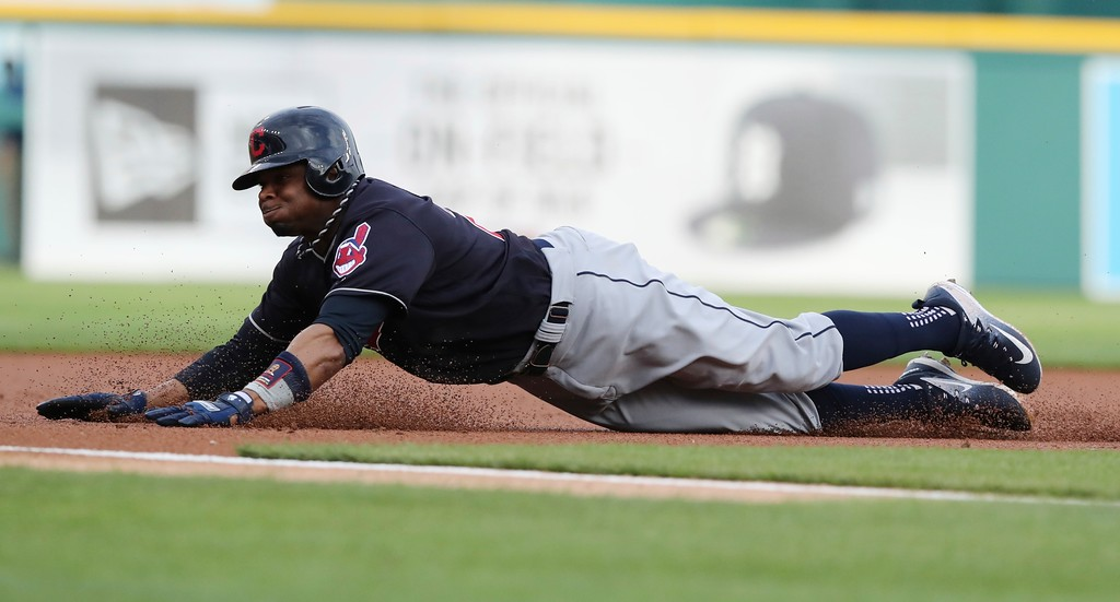 . Cleveland Indians\' Rajai Davis safely slides into third during the first inning of a baseball game against the Detroit Tigers, Tuesday, May 15, 2018, in Detroit. (AP Photo/Carlos Osorio)