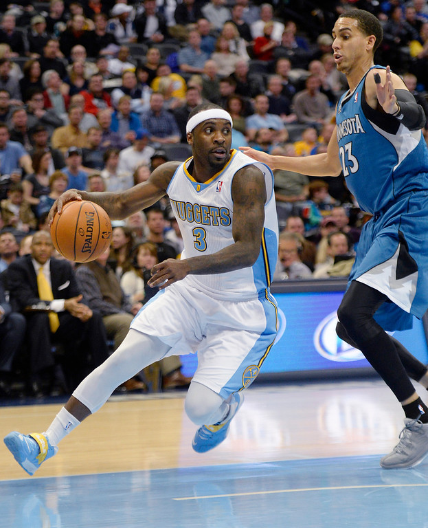. Ty Lawson (3) of the Denver Nuggets drives on Kevin Martin (23) of the Minnesota Timberwolves during the first quarter at the Pepsi Center. (Photo By AAron Ontiveroz/The Denver Post)