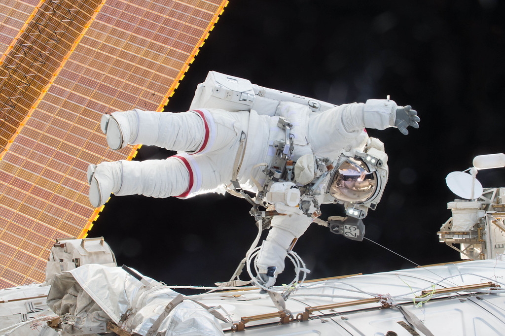 . In this Dec. 21, 2015 photo, Expedition 46 Commander Scott Kelly participates in a spacewalk outside the International Space Station in which he and Flight Engineer Tim Kopra, not pictured, moved the station\'s mobile transporter rail car ahead of the docking of a Russian cargo supply spacecraft. (NASA via AP)