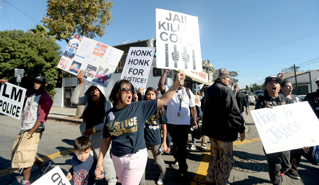 . Community members, friends and family of  Tyler Woods, who was shot by the Long Beach Police Department on Nov. 19, protested shooting death with a march to the police department headquarters in Long Beach on Sunday, November 24, 2013. (Photo by Sean Hiller/ Daily Breeze).