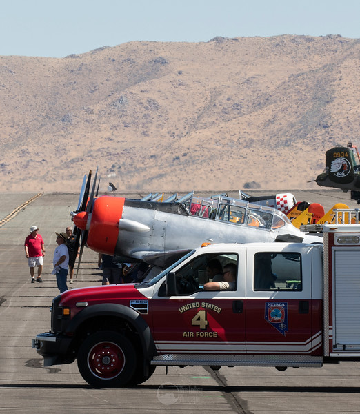 Air Force Rescue Vehicle and T-6s on the Ramp
