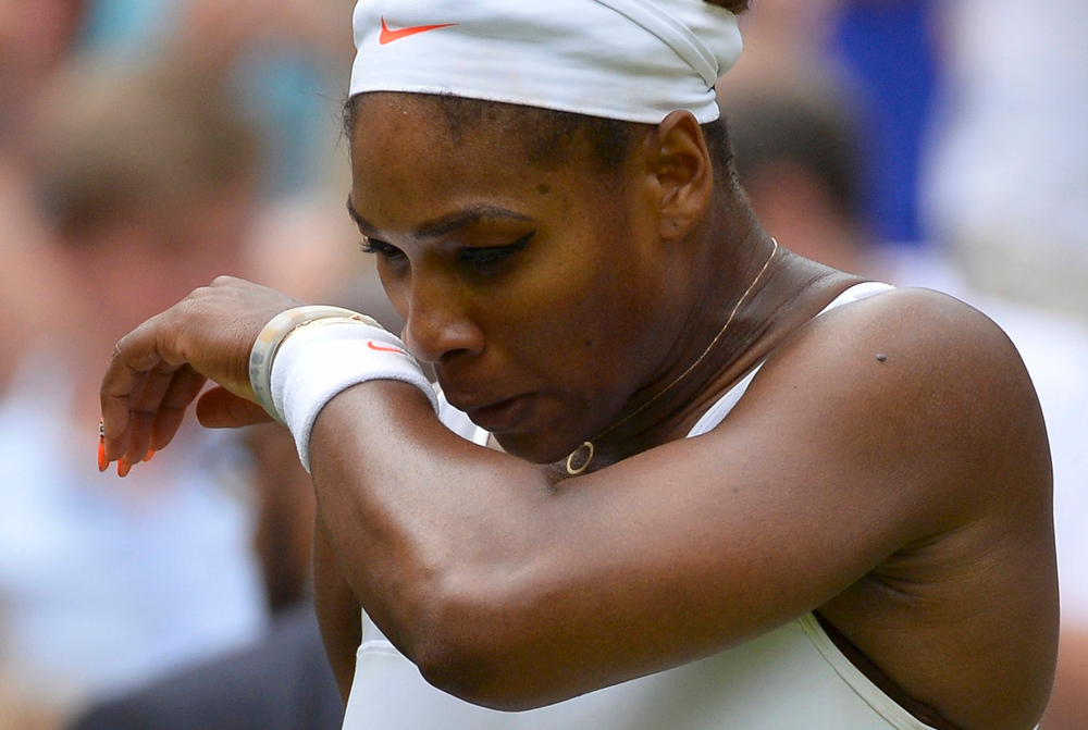 . Serena Williams of the U.S. reacts during her women\'s singles tennis match against Sabine Lisicki of Germany at the Wimbledon Tennis Championships, in London July 1, 2013.         REUTERS/Toby Melville