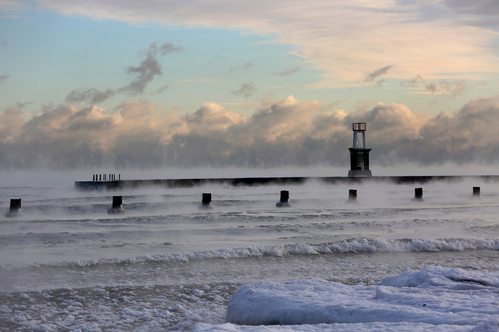 . Lake Michigan is steaming in the morning as temperatures dipped below zero at North Avenue Beach, Tuesday, Dec. 26, 2017, in Chicago. Meteorologists warn of sub-zero frigid arctic air and dangerously cold wind chills.  (Nancy Stone/Chicago Tribune via AP)