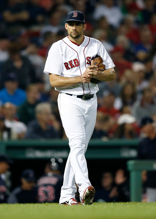 . Boston Red Sox\'s Nathan Eovaldi walks back to the mound after an RBI single by Cleveland Indians\' Yan Gomes during the fourth inning of a baseball game in Boston, Tuesday, Aug. 21, 2018. (AP Photo/Michael Dwyer)