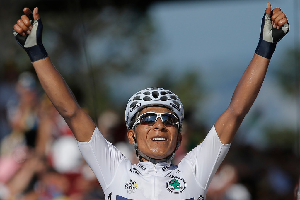 . Nairo Alexander Quintana of Colombia, wearing the best young rider\'s white jersey, crosses the finish line to win the 20th stage of the Tour de France cycling race over 125 kilometers (78.1 miles) with start in in Annecy and finish in Annecy-Semnoz, France, Saturday July 20 2013. (AP Photo/Peter Dejong)