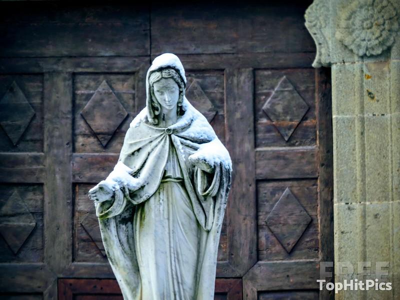 A Snowy Madonna Statue near Monte Amiata in Tuscany, Italy