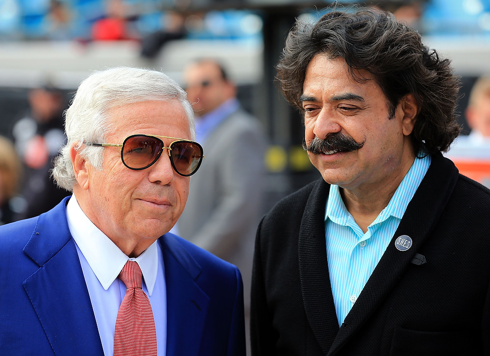 . New England Patriots owner Robert Kraft speaks with Shahid Kahn owner of the Jacksonville Jaguars prior to the game between the Jacksonville Jaguars and the New England Patriots at EverBank Field on December 23, 2012 in Jacksonville, Florida.  (Photo by Sam Greenwood/Getty Images)