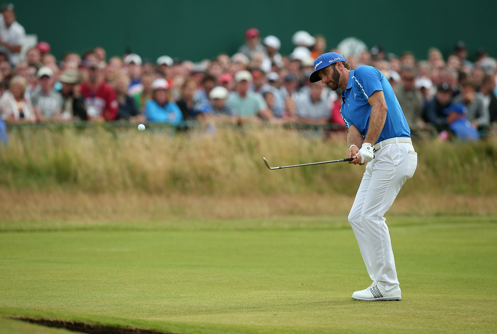 . US golfer Dustin Johnson chips to the 18th green during his fourth round 72, on the final day of the 2014 British Open Golf Championship at Royal Liverpool Golf Course in Hoylake, north west England on July 20, 2014.   ANDREW YATES/AFP/Getty Images