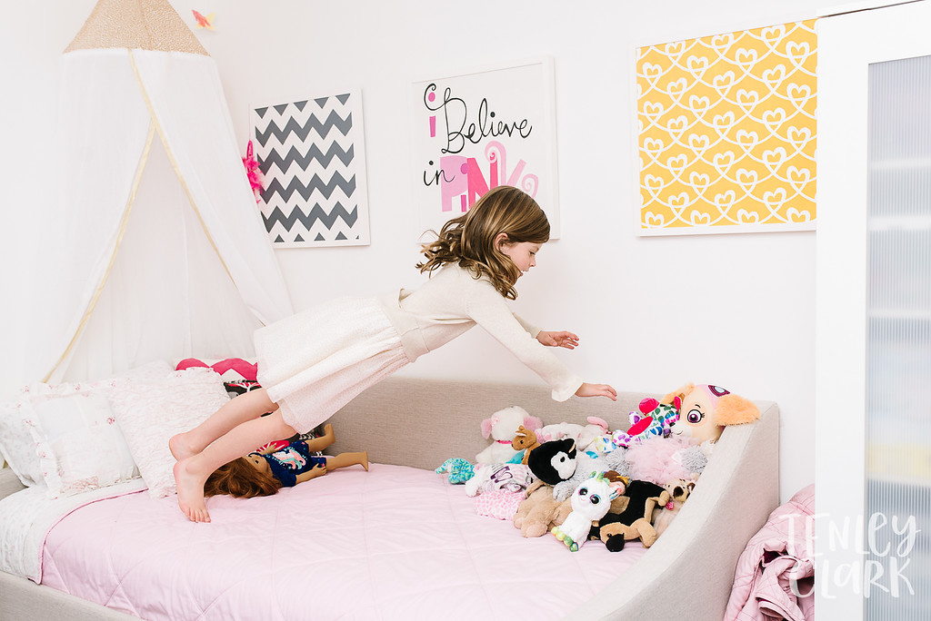 Little girl jumping on bed.Lifestyle in-home family photoshoot in Marin, CA by Tenley Clark Photography.