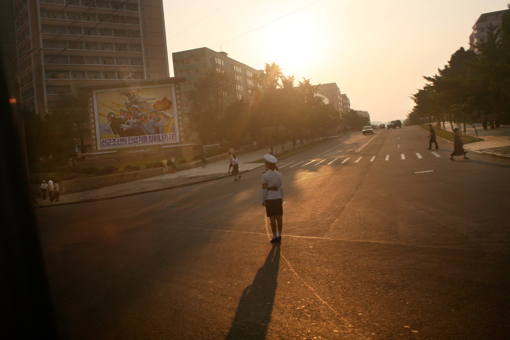 Description of . A North Korean police woman directs traffic in Pyongyang, North Korea on Tuesday, Sept. 16, 2008.  (AP Photo/David Guttenfelder)