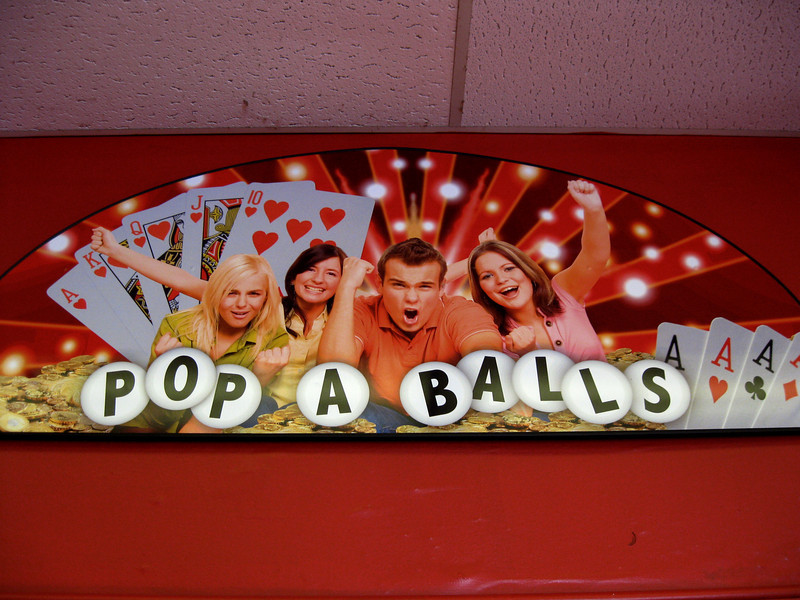 A funny Pop A Balls sign. The actual game isn't as exciting as these people make it appear.