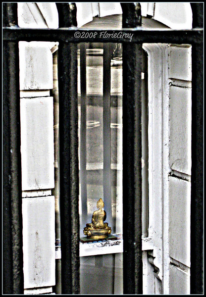 The Serenity of Security; or Buddha Behind Bars; London, England    Copyright ©2009 Florence T. Gray. This image is protected under International Copyright laws and may not be downloaded, reproduced, copied, transmitted or manipulated without written permission.