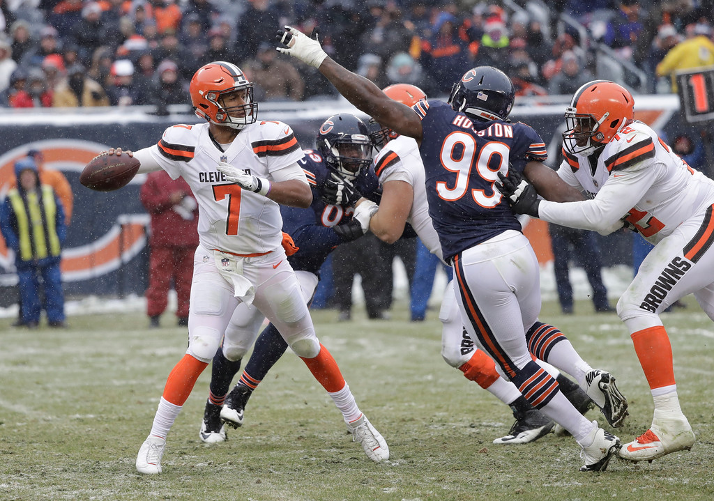 . Cleveland Browns quarterback DeShone Kizer (7) throws under pressure from Chicago Bears linebacker Lamarr Houston (99) in the second half of an NFL football game in Chicago, Sunday, Dec. 24, 2017. (AP Photo/Charles Rex Arbogast)
