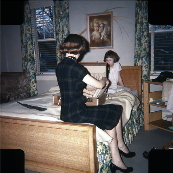 Apparently- and I'm guessing here- I was left to water the garage but Susan (always the favorite) got to help Mom pack when she went on a hit. Taken in 1957 or later.