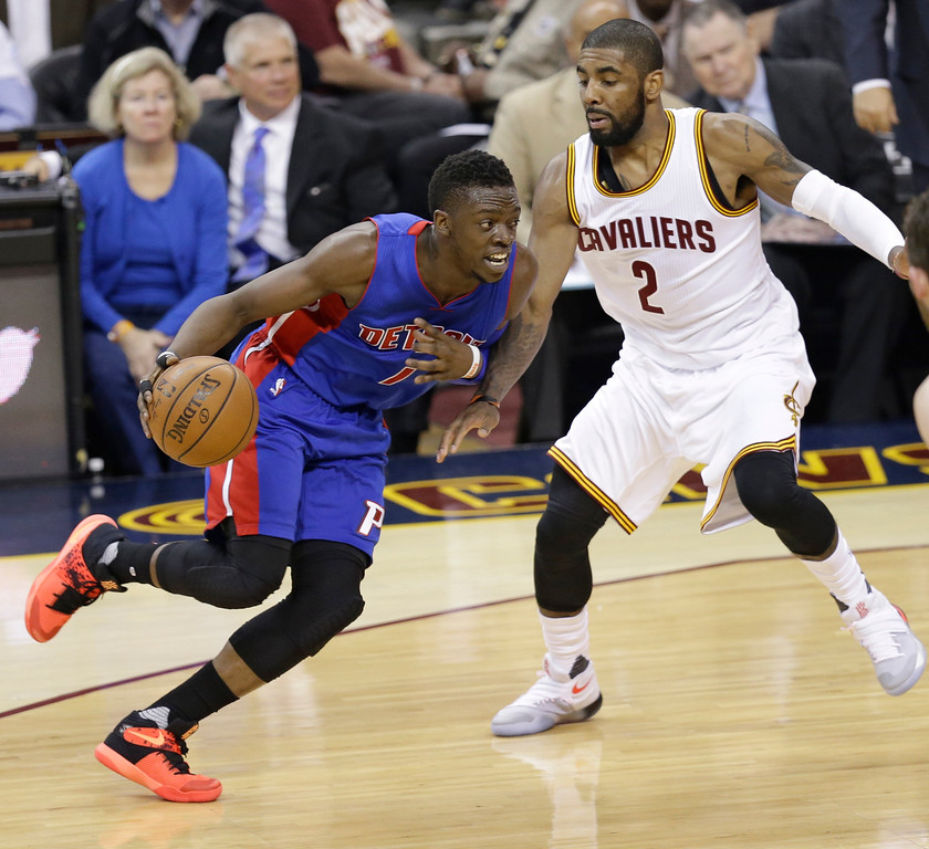 . Detroit Pistons\' Reggie Jackson (1), from Italy, drive past Cleveland Cavaliers\' Kyrie Irving (2) in the first half in Game 2 of a first-round NBA basketball playoff series, Wednesday, April 20, 2016, in Cleveland. (AP Photo/Tony Dejak)
