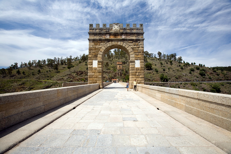 The triumphal arch in the middle of the Roman bridge of Alcantara, Caceres, Spain