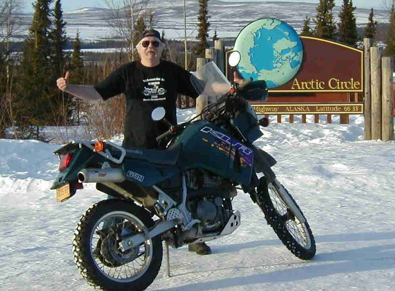 2/?/06 - Thinking of making a winter trip to Deadhorse, Roger Bliss (Wheeldog) and I haul his KLR 650 to the Haul Rd and try it out.  After two miles of riding on the slippery stock tires, I decide the best place for the bike is back in the bed of his pickup.  But we unloaded it at the Arctic Circle long enough for some hammed up photos.