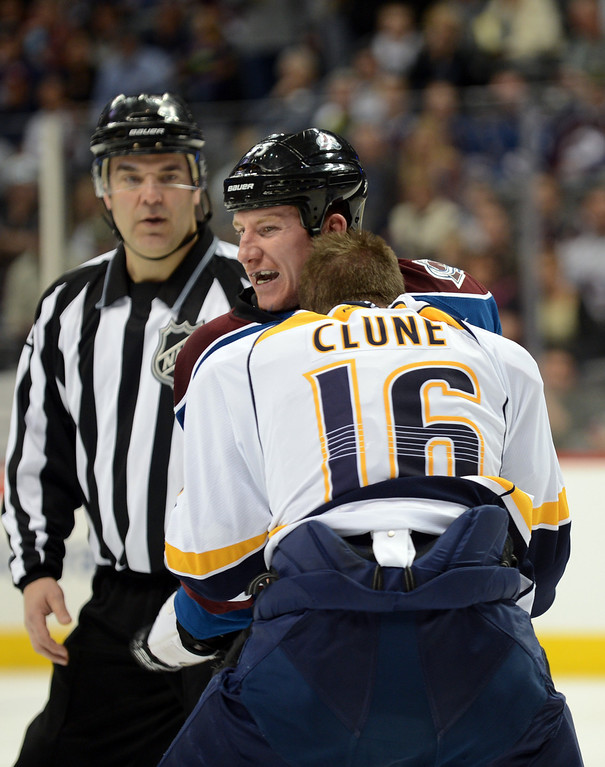 . Cody McLeod of Colorado Avalanche (#55) and Rich Clune of Nashville Predators (#16)  fighting in the 1st period of the game at Pepsi Center. Denver, Colorado. March 30, 2013. (Photo By Hyoung Chang/The Denver Post)