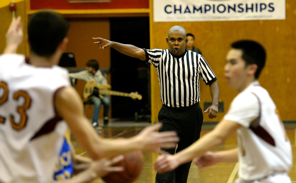 . The official keeps an eye on the game in the first half of a prep basketball game between San Dimas and Wilson at Wilson High School in Hacienda Heights, Calif., on Friday, Jan. 31, 2014. (Keith Birmingham Pasadena Star-News)