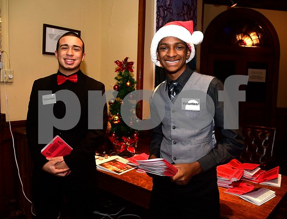 12/17/2016 Mike Orazzi | Staff Manny Benitaz and Dylan Washington hand out programs while volunteering during the 2nd Annual Tuba Christmas at Trinity-On-Main in downtown New Britain Saturday.