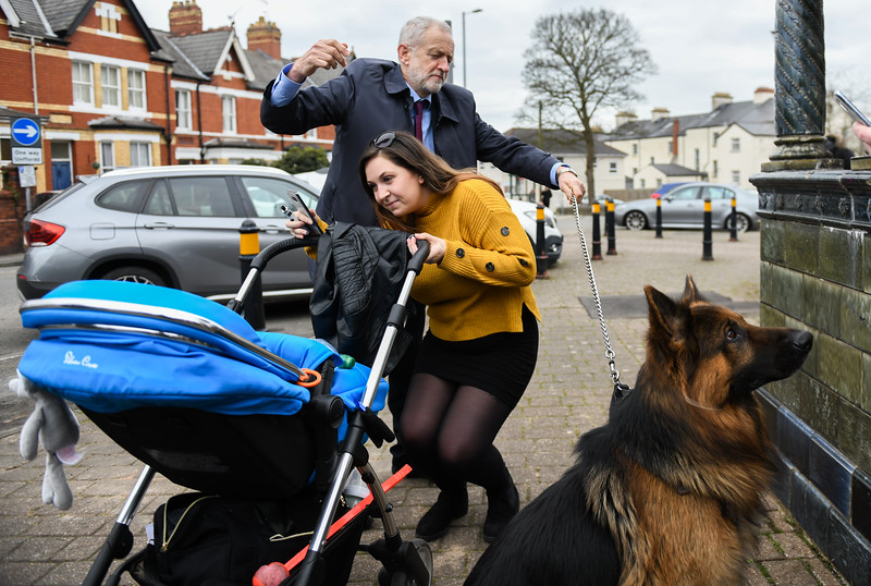 Jeremy Corbyn meets an alsatian dog on the streets of Newport South Wales.