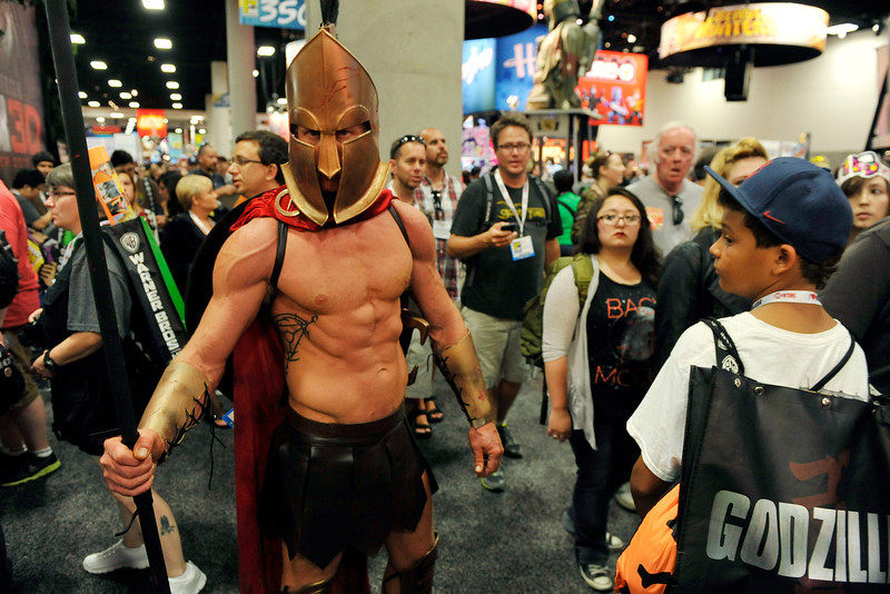 . Dressed as a Trojan soldier, Todd Schmidt of San Diego, Calif., makes his way through the crowd during the Preview Night event on Day 1 of the 2013 Comic-Con International Convention on Wednesday, July 17, 2013 in San Diego, Calif. (Photo by Chris Pizzello/Invision/AP)