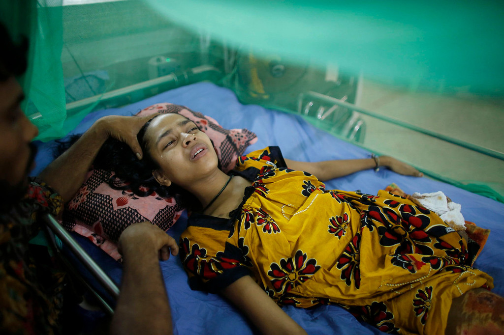 . Mustafizur tries to comfort his wife Rebecca, 20, a garment worker rescued from the rubble of the collapsed Rana Plaza building, at the National Institute of Traumatology and Orthopaedic Rehabilitation (NITOR) in Dhaka July 3, 2013. The April 24 collapse of the Rana Plaza complex, built on swampy ground outside Dhaka with several illegal floors, killed 1,132 workers and focused international attention on sometimes lax safety standards in Bangladesh\'s booming garment industry. At least five different Bangladesh agencies have dispatched teams to start inspecting the country\'s thousands of garment factories, but there has been little coordination between them. More than four million people, mostly women, work in Bangladesh\'s clothing sector, which is the country\'s largest employment generator, with annual exports worth $21 billion.   REUTERS/Andrew Biraj