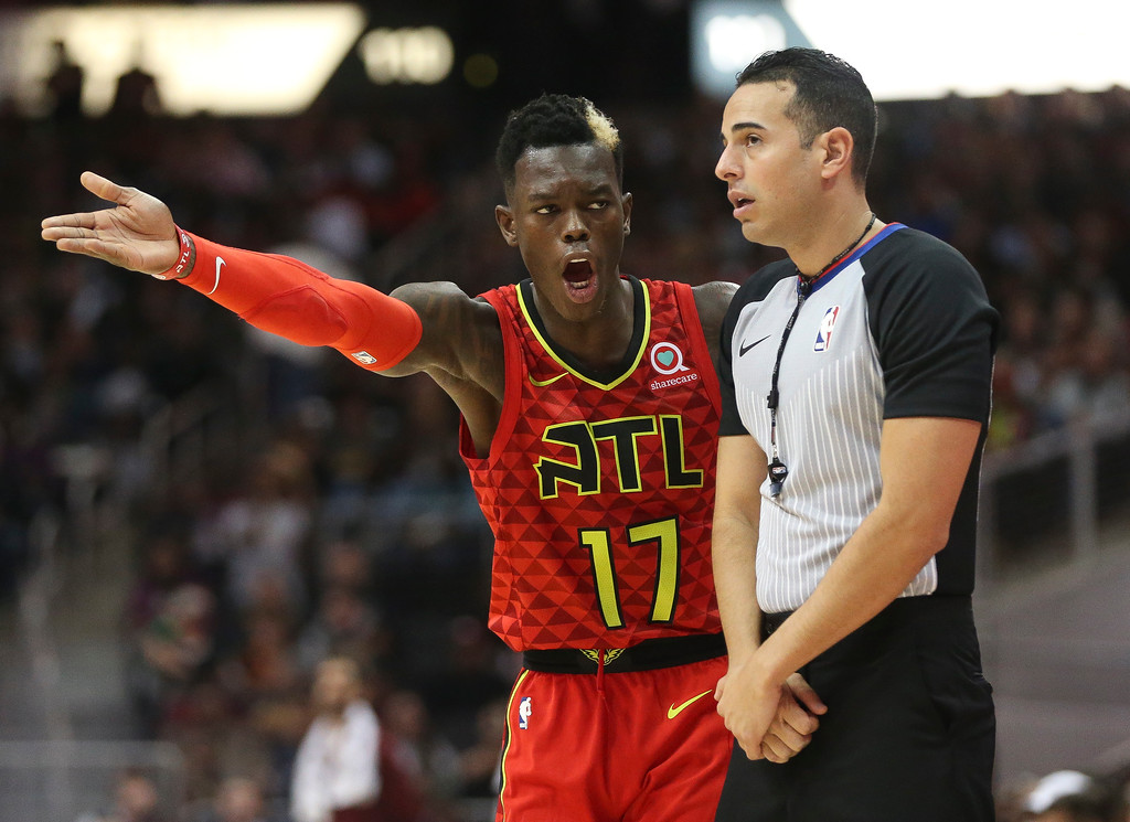 . Atlanta Hawks guard Dennis Schroder (17) agrees with an official in the second half of an NBA basketball game against the Cleveland Cavaliers Thursday, Nov. 30, 2017, in Atlanta. Cleveland won 121-114. (AP Photo/John Bazemore)