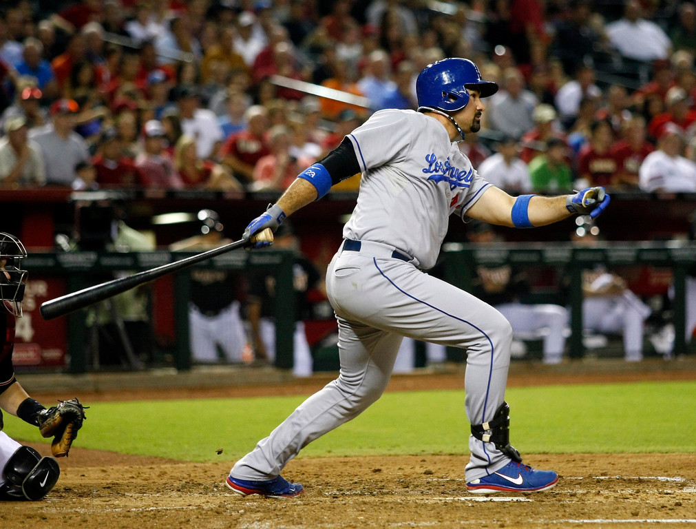 . Los Angeles Dodgers first baseman Adrian Gonzalez hits an RBI single in the fifth inning during a baseball game against the Arizona Diamondbacks on Monday, July 8, 2013, in Phoenix. (AP Photo/Rick Scuteri)