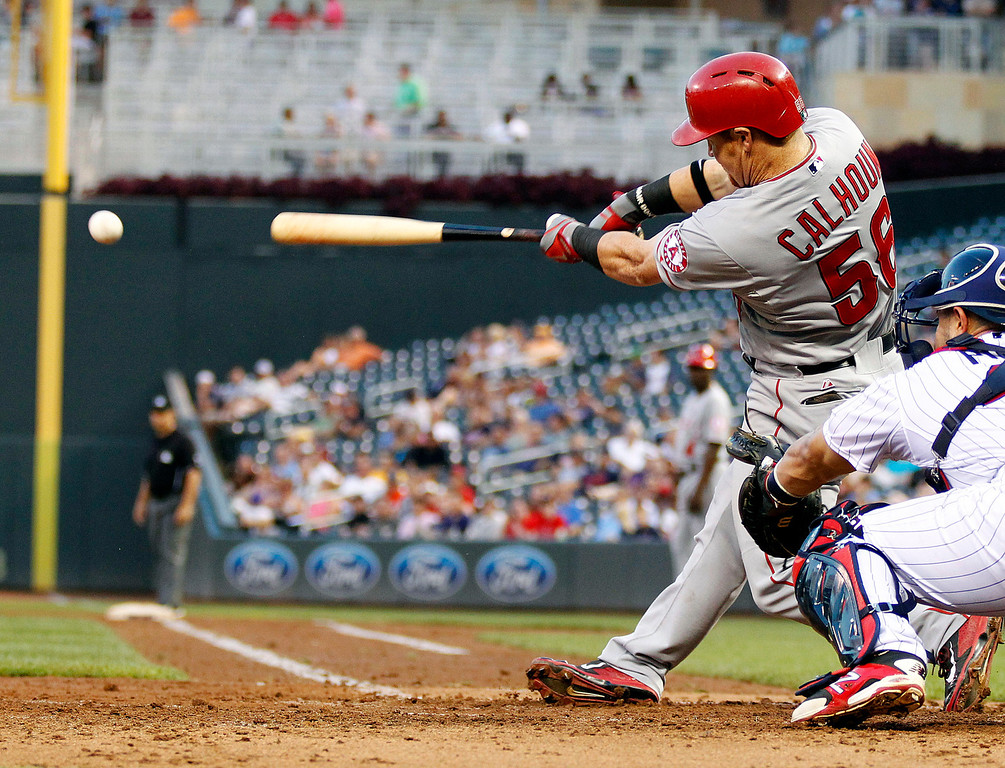 . Los Angeles Angels Kole Calhoun (56) connects on an RBI double against Minnesota Twins pitcher Pedro Hernandez in the fourth inning of their baseball game in Minneapolis Monday, Sept. 9, 2013.(AP Photo/Andy Clayton-King)