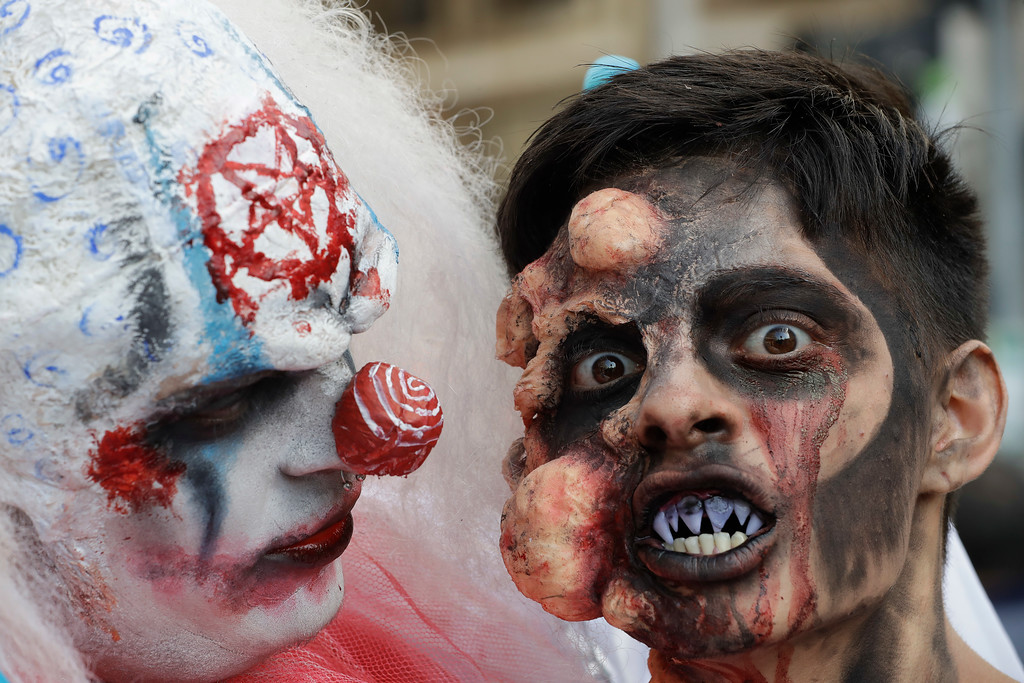 . Participants take part in the Zombie Walk in Sao Paulo, Brazil, Thursday, Nov. 2, 2017. Participants commemorated the Day of the Dead with the annual Zombie Walk. (AP Photo/Andre Penner)