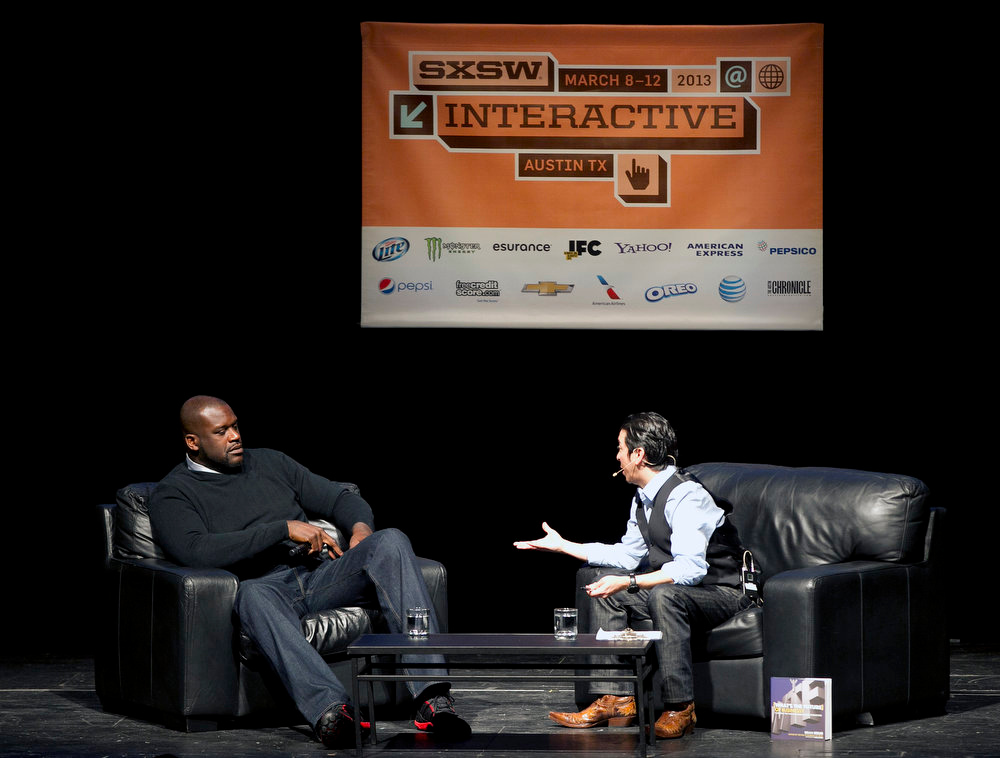 . Former NBA basketball great Shaquille O\'Neal talks with Brian Solis at the South By Southwest Interactive Festival on Monday, March 11, 2013 in Austin, Texas. (AP Photo/Statesman.com, Deborah Cannon)