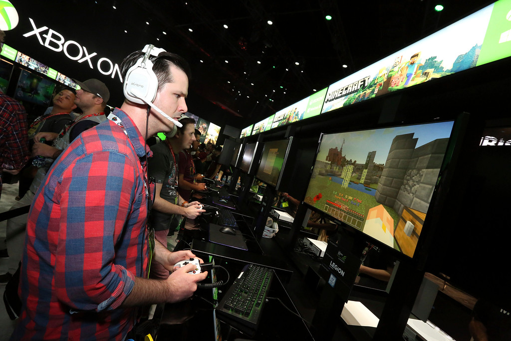 ". IMAGE DISTRIBUTED FOR MICROSOFT - Fans get serious about playing ""Minecraft\"" at the Xbox booth at E3 2017 in Los Angeles on Tuesday, June 13, 2017. (Photo by Casey Rodgers/Invision for Microsoft/AP Images)"