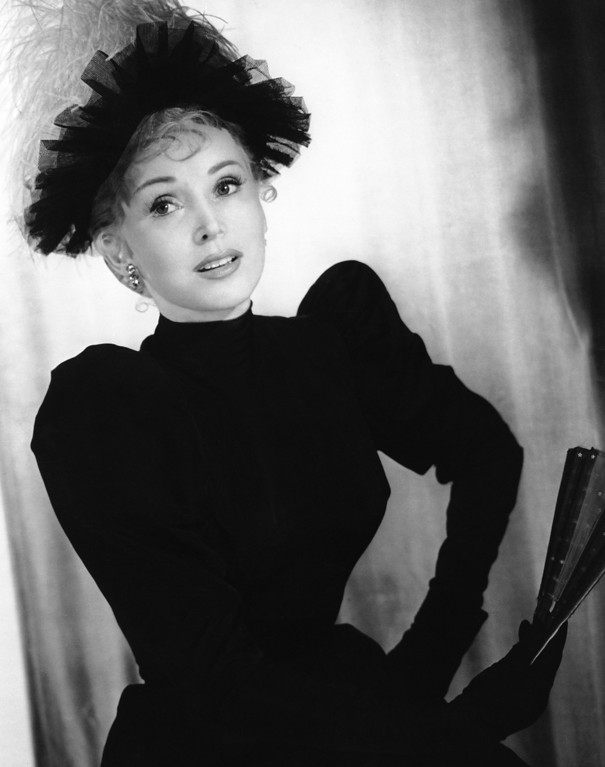 ". Zsa Zsa Gabor, as she appears in the Paquin\'s sequence in the role of Jane Avril in director John Huston\'s 1952 Technicolor production "" Moulin Rouge\""    She wears this black poult high-necked dress.   Black tulle hat trimmed with Ostrich feather plume. (AP Photo)"