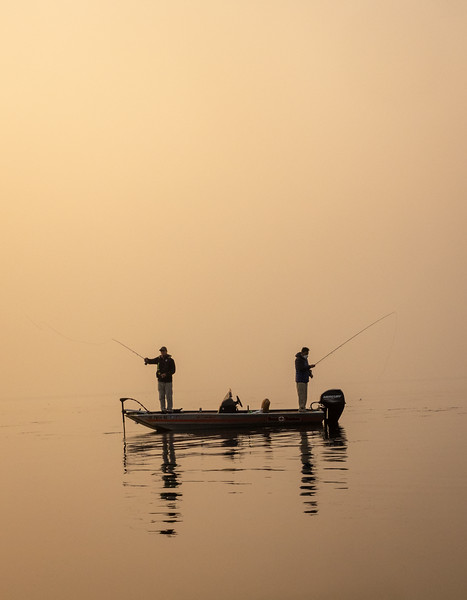 Fly Fishermen Casting Amid Wildfire-Colored Sky
