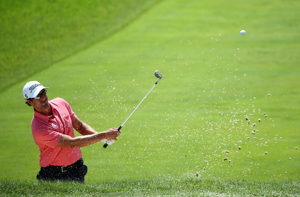 . Adam Scott of Australia hits a shot from a bunker on the fourth hole during Round Two of the 113th U.S. Open at Merion Golf Club on June 14, 2013 in Ardmore, Pennsylvania.  (Photo by Andrew Redington/Getty Images)