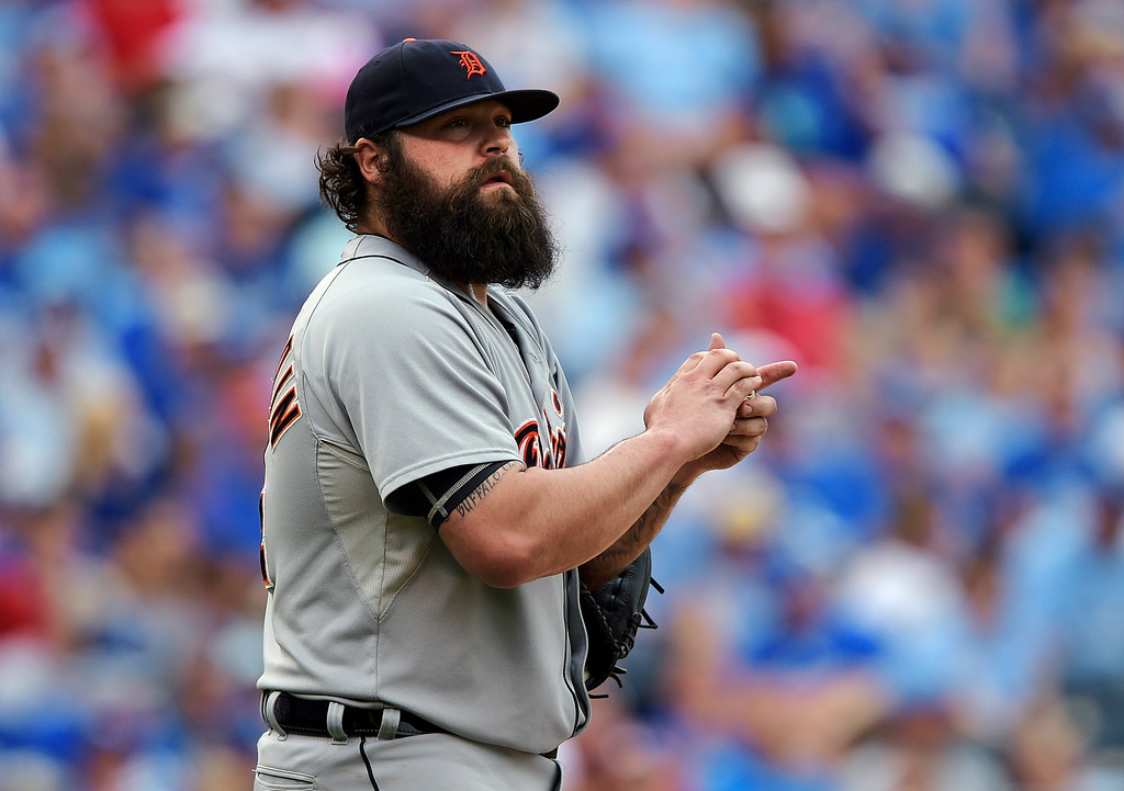 . Detroit Tigers relief pitcher Joba Chamberlain (44) prepares to throw against the Kansas City Royals during the eighth inning of a baseball game Saturday, Sept. 20, 2014, in Kansas City, Mo. (AP Photo/Reed Hoffmann)