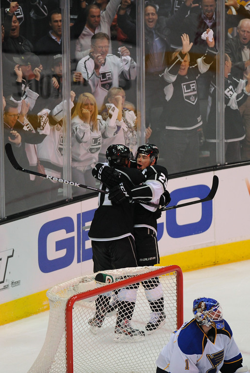 . The Kings\' Anze Kopitar, left, celebrates with Dustin Brown after scoring against the St. Louis Blues in the third period. (Michael Owen Baker/Staff Photographer)